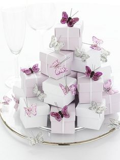 http://ljenf.tumblr.com/post/16509607473/raspberrytart-favour-boxes-butterfly-trims