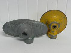 Two Vintage Metal Working Sprinklers  Vintage by NewLIfeVintageRVs, $14.00 I may be starting a new collection - I love old sprinklers!