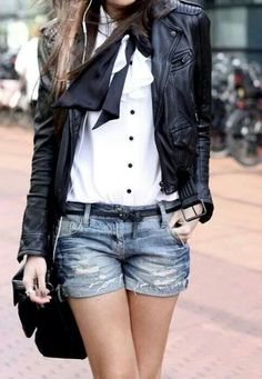 Leather jacket, white shirt, denim shorts.