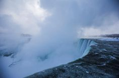 Mist rises over the Horseshoe Falls during sub-freezing temperatures in Niagara Falls on March 3, 2014.