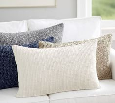 I can't decide which color I like best. I love them all! Honeycomb Lumbar Pillow Cover | Pottery Barn
