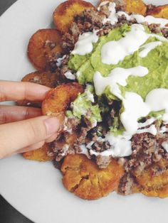 Loaded Nachos (Tostones). New favorite meal. The fried plantains are a fantastic substitute for tortilla chips and give a subtle hint of sweetness to every bite.