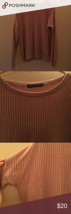 """Brandy Melville Ollie knit sweater in beige pink in good condition, apart from a couple of snags (pictured). Sweater is cute and oversized, for reference, I'm 5'4""""! Brandy Melville Sweaters"""