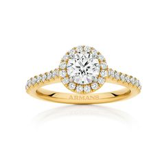 Fine delicate detail of this 1ct round brilliant cut diamond halo engagement ring truly exposes the centre diamond as the main feature. Having fine mellè round brilliant diamond solest set the centre stone and through the band handmade in Yellow Gold. See more at http://www.armansfinejewellery.com/engagement-rings