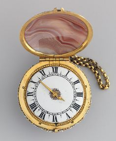 Watch, ca. 1650–60 - Movement by Charles Bobinet (Swiss, 1610–1678) - Case: pink agate, mounted in enameled gold; Dial: painted enamel with a single gilded–brass hand; Movement: gilded brass and steel, partly blued.  Gift of J. Pierpont Morgan, 1917  (Charles Bobinet: Watch Heilbrunn Timeline of Art History | The Metropolitan Museum of Art)