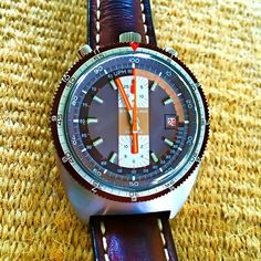 c1972 Breitling 7101 Pupite / Pult in Chocolate Brown w/ Orange.\