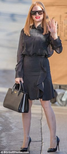 Chic: The actress, 39, stole the spotlight as she showed off her toned legs in a stunning ruffled mini-skirt and chic semi-sheer blouse