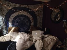Dark navy walls with pretty tapestries and christmas lights. Looks so comfy i just wanna curl up in that room and never leave!!