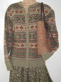 L A U R A A S H L E Y  I dont like ephemeral things, I like things that last forever  THIS TRADITIONAL CARDIGAN CAPTURES THE VERY ESSENCE OF ENGLISH COUNTRY LIFE. IN 100% PURE NEW WOOL IT WILL KEEP YOU WARM, THE FAIR ISLE PATTERN IN NATURAL, EARTHY COLOUR TONES OF PALE OLIVE, RUSSET BROWN, NAVY, HEMP & PINE ADD COTTAGE STYLE CHARM TO YOUR AUTUMN/WINTER/SPRING WARDROBE. FRONT FASTENING WITH SEVEN HORN EFFECT BUTTONS FROM THE CREW NECK DOWN TO THE RIBBED WELT, WHICH FITS SNUG TO Y...