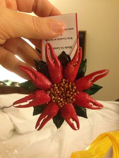"""I picked up this """"Cajun Poinsettia"""" Christmas ornament at The Louisiana Market in Lake Charles, Louisiana. It is made out of crawfish claws and garfish scales!  It is so cute!  I can't wait to hang it on my tree!!  Check out their web page. www.thelouisianamarket.com"""