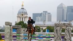 Equestrian, London 2012   Michael Jung of Germany riding Sam negotiates a jump in the Individual Jumping Equestrian Final on Day 4 of the London 2012 Olympic Games at Greenwich Park