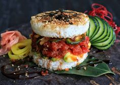 "This burger features spicy tuna, avocado, cucumbers, and oshinko between grilled rice ""buns"" topped with seaweed."