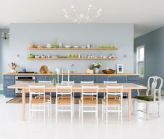 Modern Saltbox Cottage    This cooking space features a crisp, uncluttered aesthetic and seaside-inspired palette.