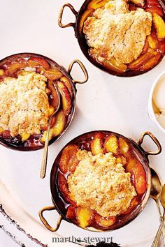 This dessert features a stone fruit duo, peaches and apricots, plus warm notes from the addition of cardamom in the fluffy drop biscuit topping. Individual portions elevate a humble cobbler into the perfect ending for an elegant dinner party. #marthastewart #recipes #recipeideas #dessert #dessertrecipes Tart Recipes, Fruit Recipes, Summer Recipes, Cooking Recipes, Delicious Recipes, Recipies, Apricot Cobbler, Peach Slab Pie, Elegant Dinner Party
