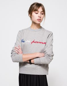 From Etre Cecile, a mid weight sweatshirt with front multi color print in Grey Marle. Features crew neckline, ribbed neckline, full length sleeves, ribbed cuffs, front handwritten 'La Vie Parisienne' slogan in textural flock print, cropped length, soft co
