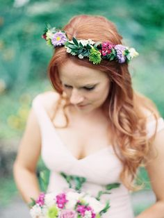 Look like a garden princess on your wedding day by pairing loose curls with a vibrant flower crown.