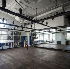 Israeli firm Jacobs-Yaniv has created a pilates studio for Paralympic gold-medallist Keren Leibovitch in Kfar Saba, Israel, using a steel frame to create distinct spaces inside a former events hall. Home Dance Studio, Dance Studio Design, Studio Room, Ballet Studio, Wellness Studio, Fitness Studio, Fitness Design, Gym Design, 1million Dance Studio