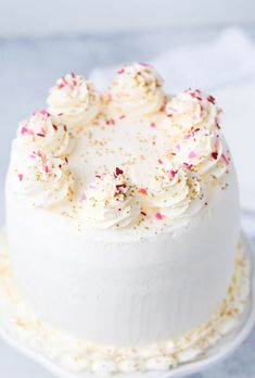 This pink champagne cake recipe combines champagne and orange juice in a soft and crumbly cake and is frosted with a silky orange swiss meringue buttercream for the perfect finish. These flavors together are incredible making this delicate cake a delight. Pink Champagne Cake, Orange Frosting, Hazelnut Cake, Swiss Meringue Buttercream, Buttercream Cake, Almond Cakes, Dessert Recipes, Desserts, Cupcake Recipes