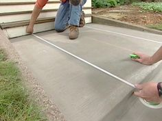 DIY Network host Paul Ryan uses a big stone slab pattern with stencils to decorate concrete for a beautiful front entrance. See how to do it on DIYNetwork.com.