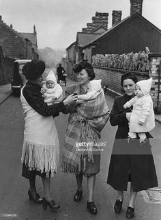 Three women with their babies after a visit to a baby clinic in the Morriston district of Swansea, Wales, December 1943. Original publication: Picture Post - 1448 - The Valley's Health Services - pub. 1st January 1944.
