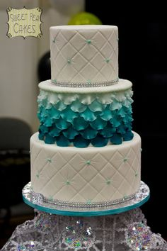 Three tier fondant dummy cake for a bridal show I was in. Quilting on top and bottom tiers. Middle has ombre fondant petals. This was my show stopper. Everyone loved it! I was so happy! #wedding #weddingcake