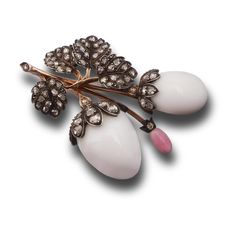 A conch pearl and diamond brooch. Of floral design, the flower buds set with two oval white conch pearls of circa 52 and 76 grains and one pink conch pearl of circa 2 grains, to leaves accented with rose-cut diamonds, mounted in silver and gold, English, circa 1880, approximately 4.5 x 3cm.