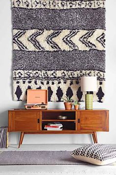 shag rug as a wall hanging...always love this look with plain white walls and wood furnishings