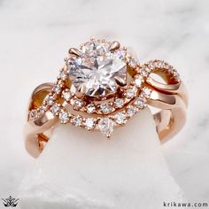 This set was done in 14k rose gold with 14k white gold vine accents on the engagement ring shank. Our Dew Drop Contoured Wedding Band in 14k rose gold is a beautiful, accentuating band that continues the organic, nature inspired theme of the set. Bridal Sets, Precious Metals, Wedding Bands, Diamond Earrings, Gold Rings, White Gold, Rose Gold, Engagement Rings, Beautiful