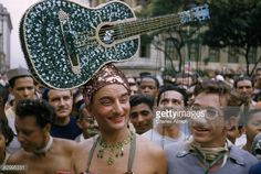 http://media.gettyimages.com/photos/carnival-merrymakers-wear-pearlencrusted-guitar-as-hat-and-fake-nose-picture-id82995331?s=594x594