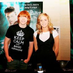 i love the fact that hermione doesnt look bothered by the shirt