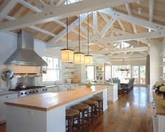 Love this kitchen - colors, ceiling, range / hood, butcher block counters, islan. Farmhouse Kitchen Island, Ranch Kitchen, Kitchen Islands, Kitchen Wood, Open Kitchen, Kitchen Sink, Kitchen Colors, Kitchen Design, Exposed Trusses