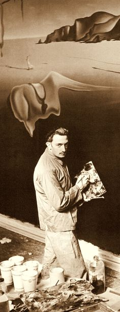 """SALVADOR DALI painting a wall facade of limp watches for his 'DREAM OF VENUS"""" funhouse pavilion for adults only. At The 1939 World's Fair. from the book Salvador Dali's Dream of Venus: The Surrealist Funhouse by Ingrid Schaffner with Photos by ERIC SCHAAL. 2002 (please follow minkshmink on pinterest)"""