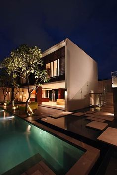 Villa Paya-Paya by Aboday Architects in Bali. The two-storey building is arranged around courtyards and surrounded by water of varying depths, creating a shallow pond at the entrance, a jacuzzi, and a large swimming pool.