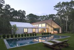 "East Hampton House - contemporary - exterior - new york - by Eisner Design LLC - Not into the pool, like the ""roof line"" for my addition project, raise the house all the way up, and connect an addition in its backyard Residential Architecture, Amazing Architecture, Architecture Design, Moderne Pools, Backyard Pool Designs, Metal Buildings, Design Case, Outdoor Rooms, Outdoor Furniture"