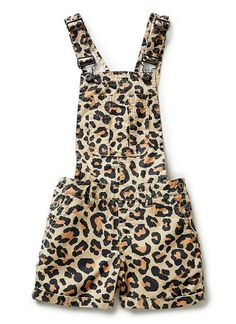 100% Cotton Dungaree. Woven twill dungaree, in short length and all-over ocelot print. Features buckle shoulder straps, front, side & back pockets. Regular fitting silhouette. Available in colour shown.
