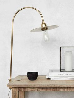 Update your home interior with this Glow table lamp from House Doctor. Wonderfully crafted from brass, this lamp is modern in design and features a gold coloured disc above the bulb which is exposed. House Doctor, Brass Table Lamps, Brass Lamp, Desk Lamp, Lampe Decoration, Decoration Design, Glow Lamp, Glow Table, Lampe Retro