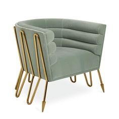 Modern Elegance.An undulating, gleaming brass frame with our signature Maxime arrow sabots cradles a cocooning, channel-tufted back upholstered in luxe celadon velvet. Sculptural, sinuous, and arresting our Maxime Club Chair is at home in a modernist masterpiece, but surprisingly comfy enough to be your favorite reading nook. Finally, a club chair for a club you'd actually want to belong to.Discover the entire Maxime Collection.