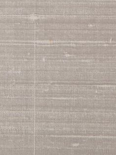 Holland and Sherry's silk wallcovering is perfect for a traditional bedroom or formal dining room.