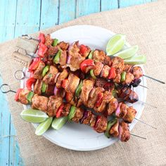 Chipotle Lime Chicken Fajita Skewers  4 chicken breasts (app 2 lbs) 5 limes (juiced) 1/2 tbsp sea salt 1/2 tbsp cumin 1 tbsp ground chipotle pepper 1/4 cup cilantro (chopped) 1 garlic clove (minced) 2 red bell peppers 2 green bell peppers 1 red onion