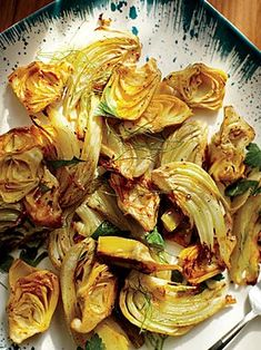 Roasted Fennel & Artichoke Hearts-Canned artichokes add subtlety and flavor to this meal. We like the Whole Foods 365 brand because the artichokes don't come out too salty when roasted. Vegetable Side Dishes, Vegetable Recipes, Vegetarian Recipes, Healthy Recipes, Veggie Side, Healthy Dinners, Yummy Recipes, Healthy Snacks, Whole Foods 365