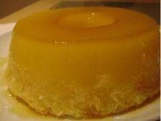 Unte uma forma para pudim com margarina e salpicar açúcar Bata todos ingredientes no liquidificador e coloque na forma Leve para assar em fo...