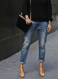 Boyfriend jeans and nude pumps.
