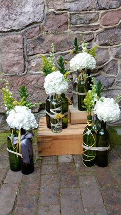 Blossom Bliss Florist Wedding Centerpiece: Reclaimed wine bottle w/ hydrangeas+yellow filler