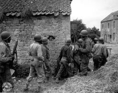 delabraters african soldiers germany | platoon of African-American troops surrounds a farm house in a town ...