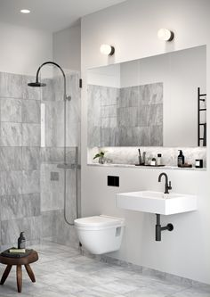 Refresh the look of your master bathroom with some modern design inspiration. This modern en-suite is one of our favorites thanks to the marble tile, sleek black accents, and monochromatic color scheme. Unique Bathroom Sinks, Ideal Bathrooms, Bathroom Sink Faucets, Modern Bathroom, Master Bathroom, Zebra Bathroom, 1920s Bathroom, Paris Bathroom, Bathroom Niche