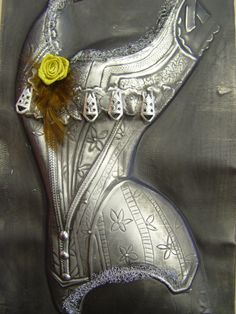 Adding a little something to your pewter work creates interest and dimension. Pewter corset  by Mary Ann Lingenfelder, Mimmic Gallery and Studio www.mimmic.co.za