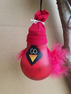 Watts This?  This cardinal is a repurposed light bulb ornament that is sure to add a splash of color to your Christmas tree! Even after the holidays are over, this cardinal will continue to warm your heart for the rest of those long winter months.  Each charming little fella is
