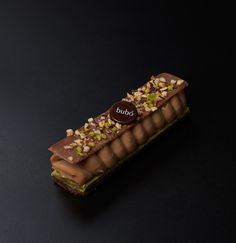 Namelaka (The gianduja cream, sits on a green tea sponge and a crunchy chocolate biscuit base. The subtle flavours combine magically and melt in the mouth. The cake is gently decorated with a fine layer of milk chocolate to add to this creamy, chocolaty combination) | bubó, Spain