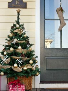 A Whole Bunch Of Christmas Porch Decorating Ideas - Christmas Decorating - I love the little star ornaments.  Sticks and spray paint oh and you could put ebson salt on them to make them look frosty same with the pine cones.