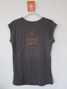 Full view of back of the most recent update of the Stone Yoga t-shirt.  This shirt surpasses the first version in color choices or the tee and ink and going with a new softer shirt.